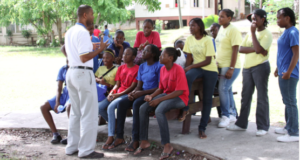 Teacher and students in a Caribbean setting